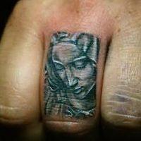 Значение тату «икона Божьей Матери»