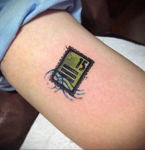Фото татуировки с почтовой маркой 01.05.2020 №039 -postage stamp tattoo- tatufoto.com