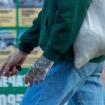 Тату с серпом на лице парня и надпись NESS с мордой дьявола на руке – 17.09.2020 – tatufoto.com 10