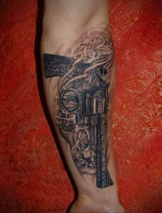 тату револьвер на руке 16.02.2021 №0005 - revolver tattoo on arm - tatufoto.com