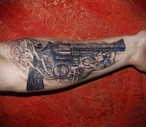 тату револьвер на руке 16.02.2021 №0007 - revolver tattoo on arm - tatufoto.com
